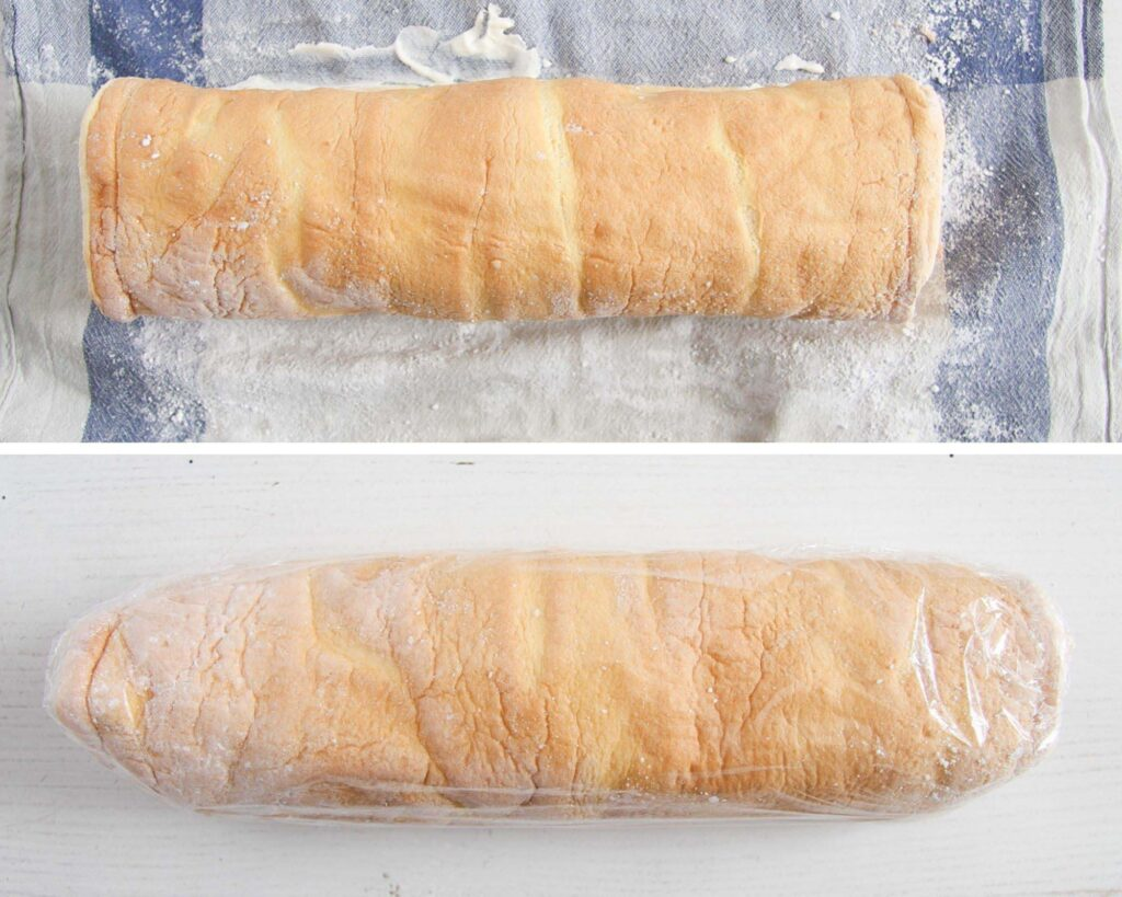 rolled cake roll wrapped in plastic on the table.