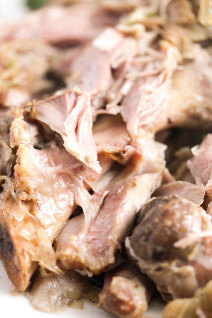 close up of shredded pork hock meat.