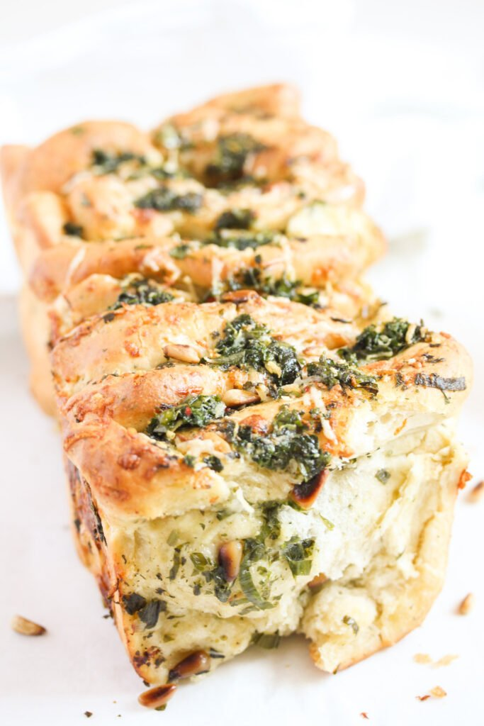 inside of a pull apart loaf with ramsons and butter.