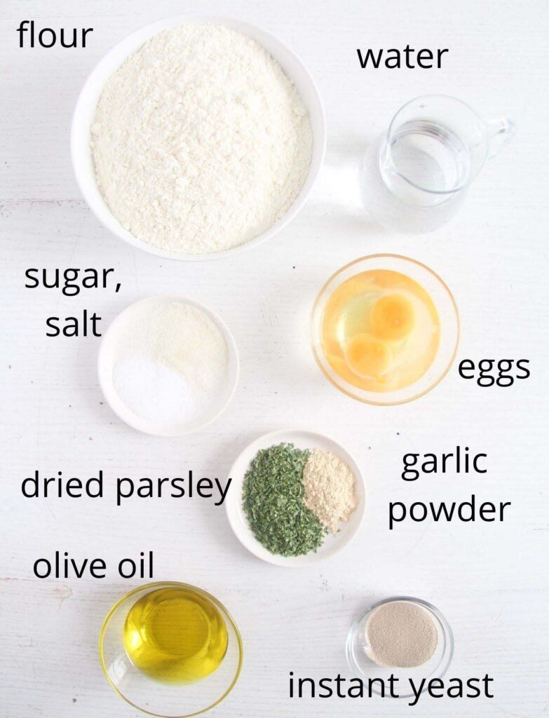 ingredients for making yeast dough with herbs.