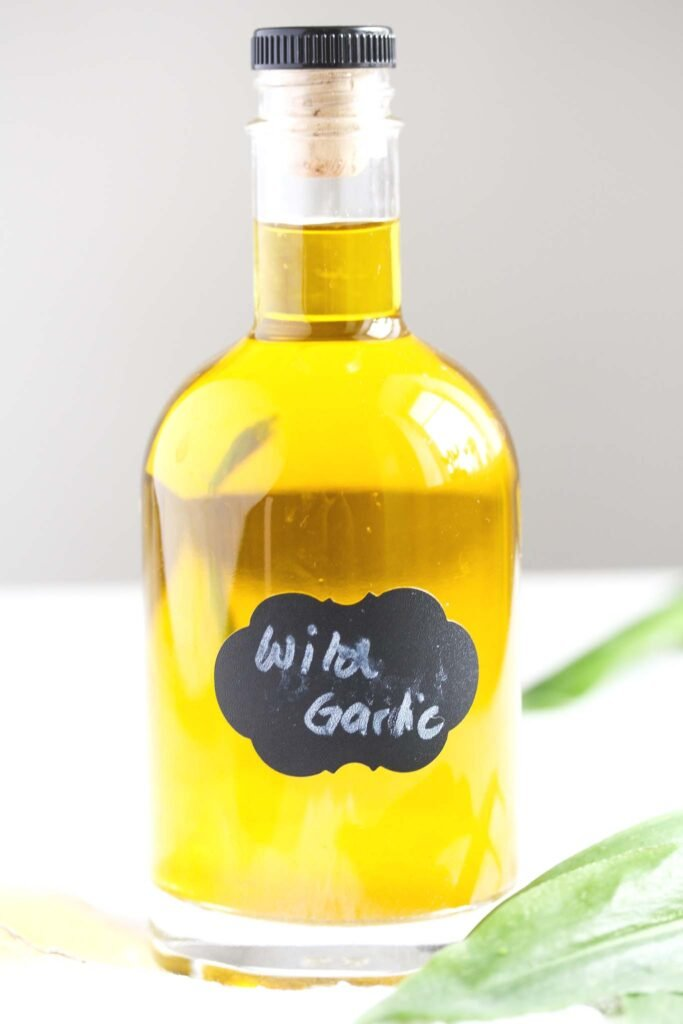 homemade infused oil with wild garlic.