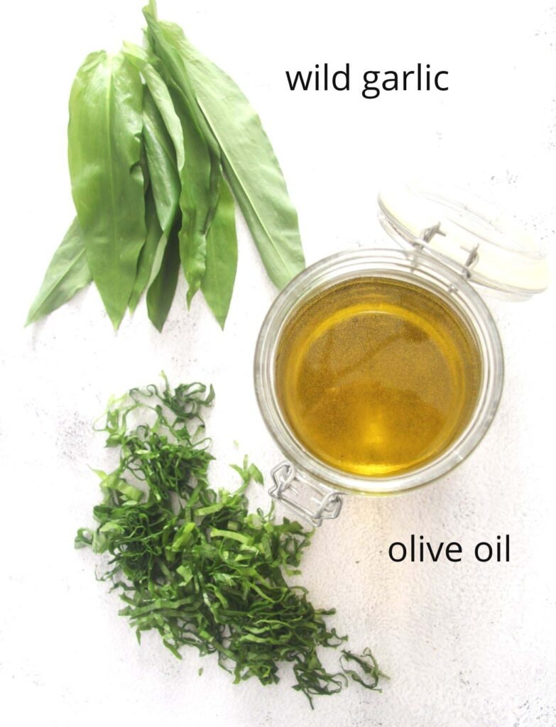 wild garlic leaves and a jar of olive oil.