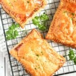 pinterest image of filled pastry on a wire rack with parsley.