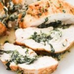 pinterest image of chicken stuffed with spinach showing the filling.