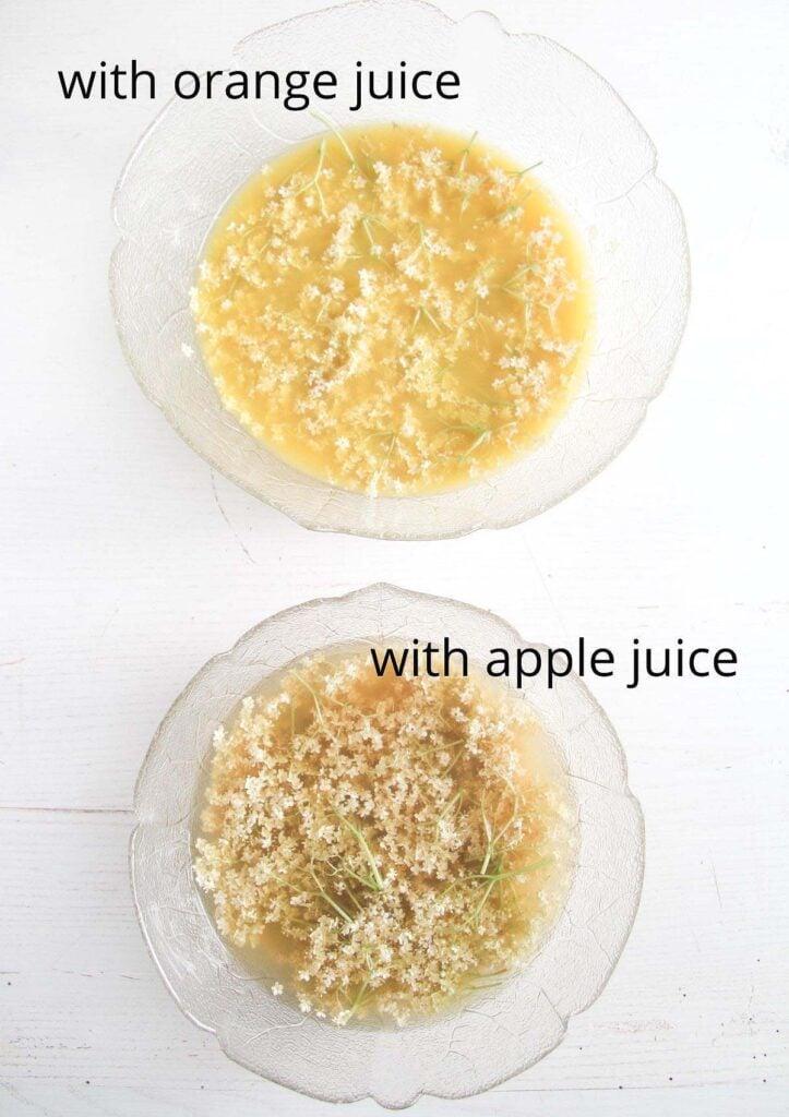 two bowls with soaking elderflowers in apple juice and in orange juice.