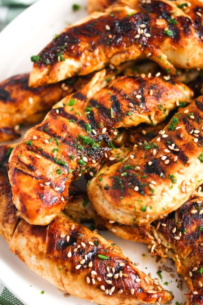 close up of chicken strips with grill marks on them.