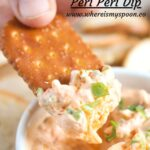 pinterest image of child's hand dipping cracker in dip.