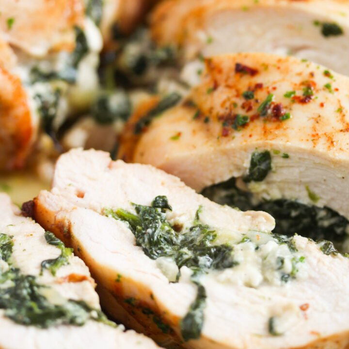 sliced chicken breast showing the creamy spinach filling.