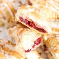 easy cherry turnovers close up, one split in two showing the filling.