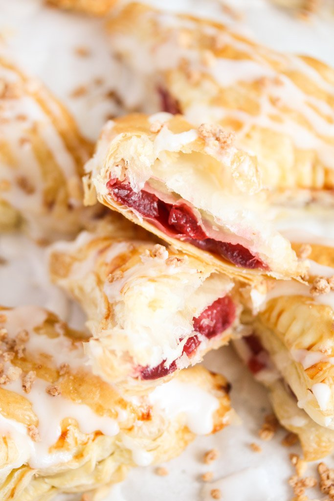 piled cherry turnovers, one showing the filling.