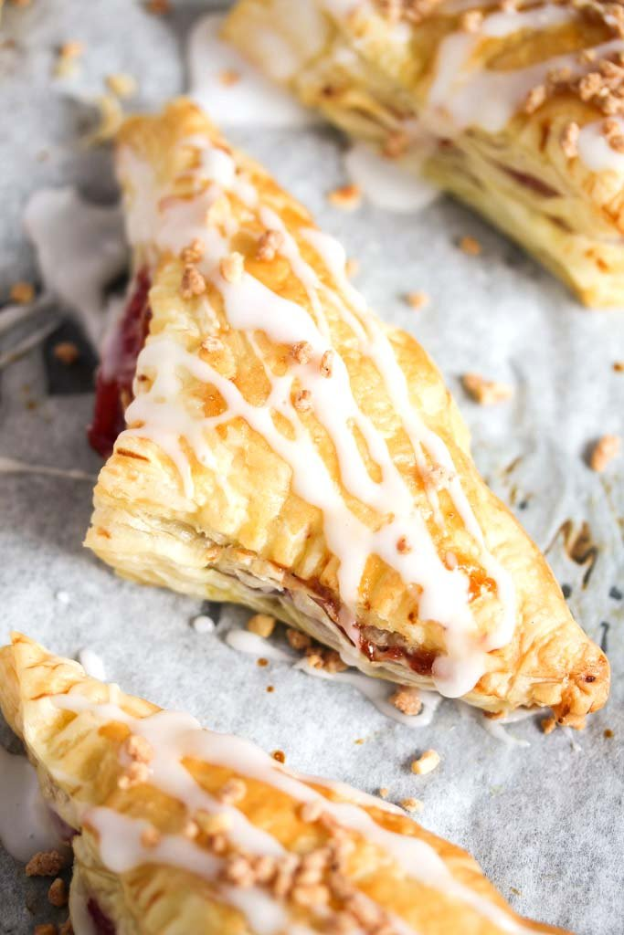 close up one puff pastry triangle glazed with icing sugar.