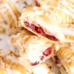 pinterest image of cherry turnovers, title written above the picture.