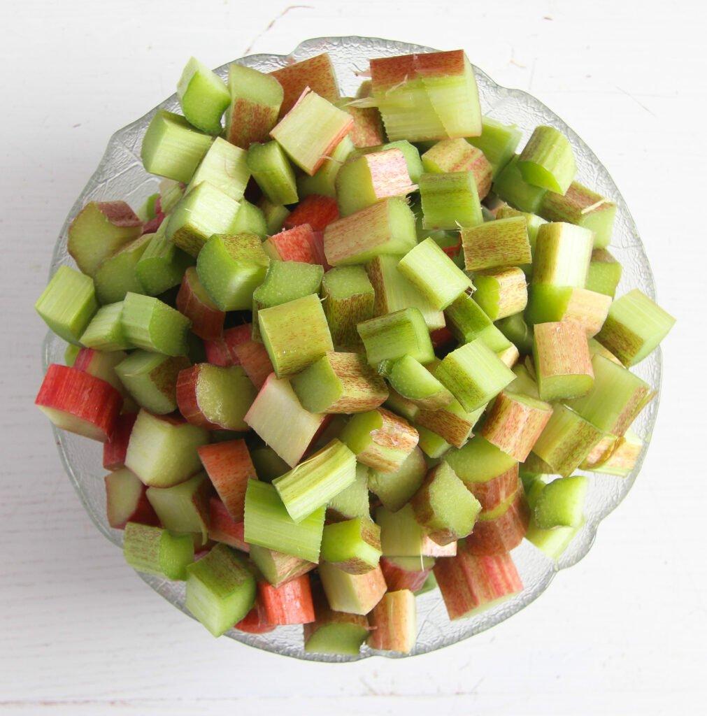 a large bowl full of chopped rhubarb.