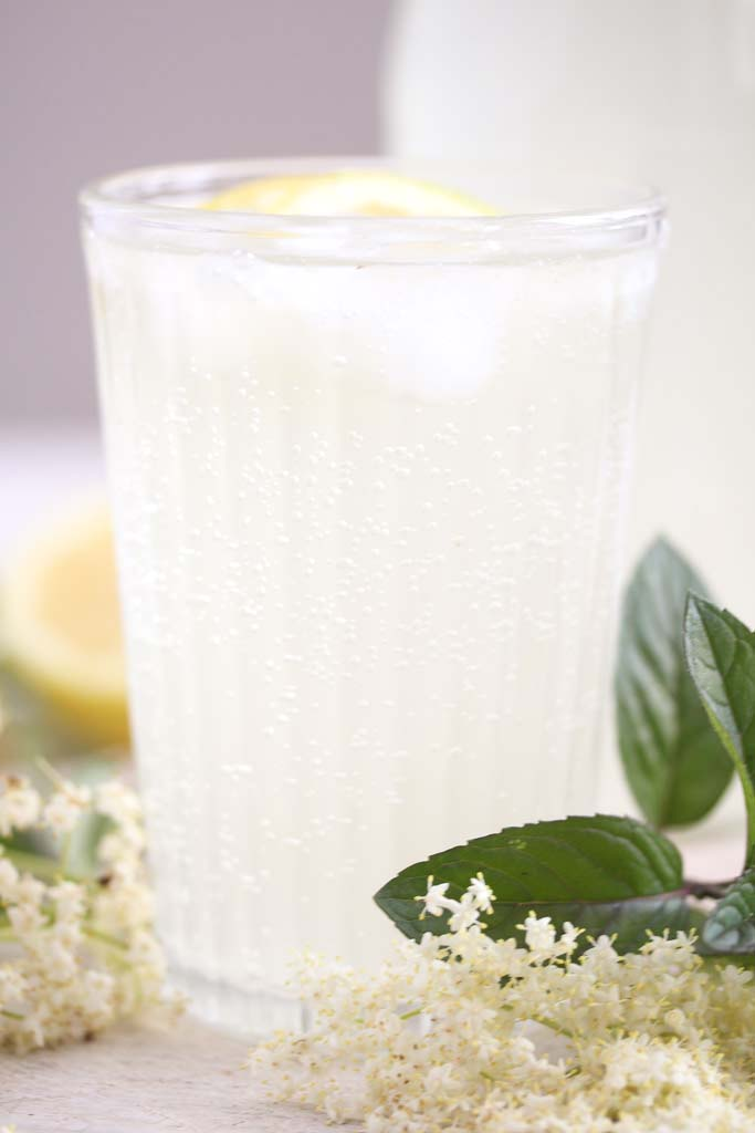 elderflower drink with sugar and lemon juice in a glass.