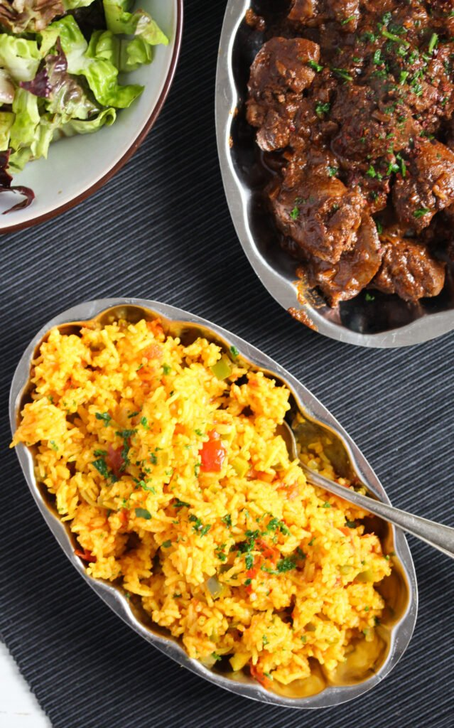 three platter with nando's spicy rice, chicken livers and salad.