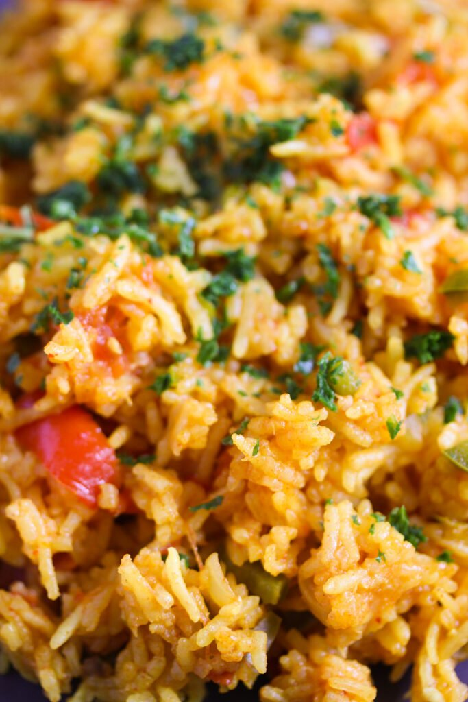 rice with tomatoes and turmeric close up on a plate.