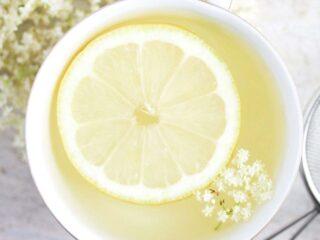elderflower tea with lemon slice inside it.