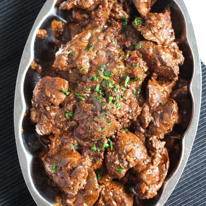 spicy peri peri chicken livers on a small vintage platter.