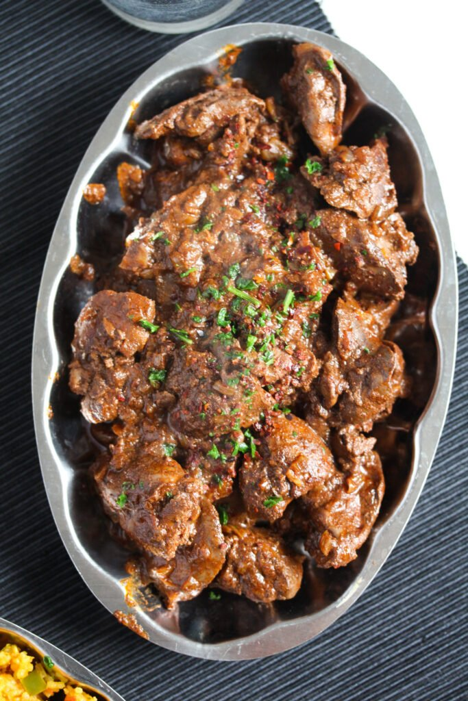 silver plattter with spicy chicken livers cooked nando style.