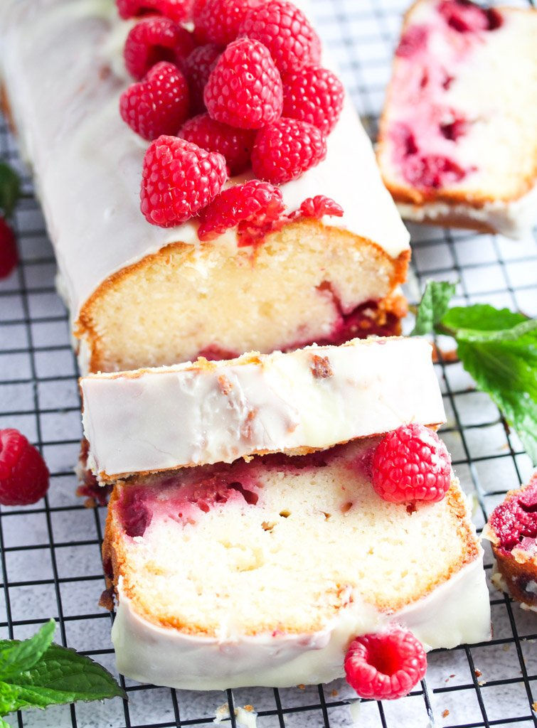 sliced white chocolate loaf topped with fresh berries.