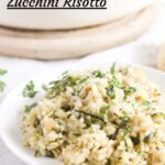 pinterest image of a plate of risotto with a large pot behind it.