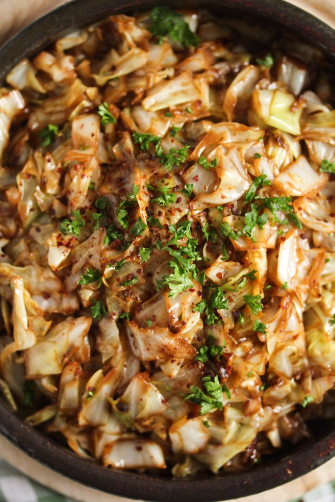 close up of cooked sweet heart cabbage in a bowl.