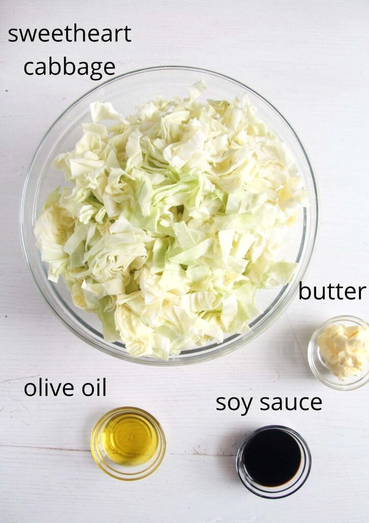 bowl of chopped cabbage, soy sauce, olive oil and butter.